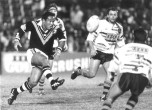 Kiwi Test hooker, Duane Mann in action for New Zealand Residents versus Australian Residents at Lang Park in 1994, watched by rival hooker, Shane Christensen.